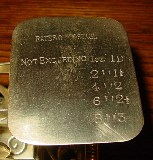 Brass letter postal scale with Griffins