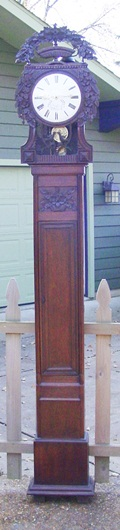 Fine tall case French clock with delicate carvings