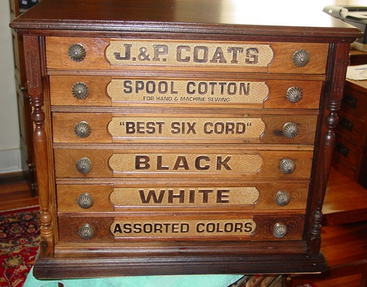 J & P Coats spool cabinet with embossed back